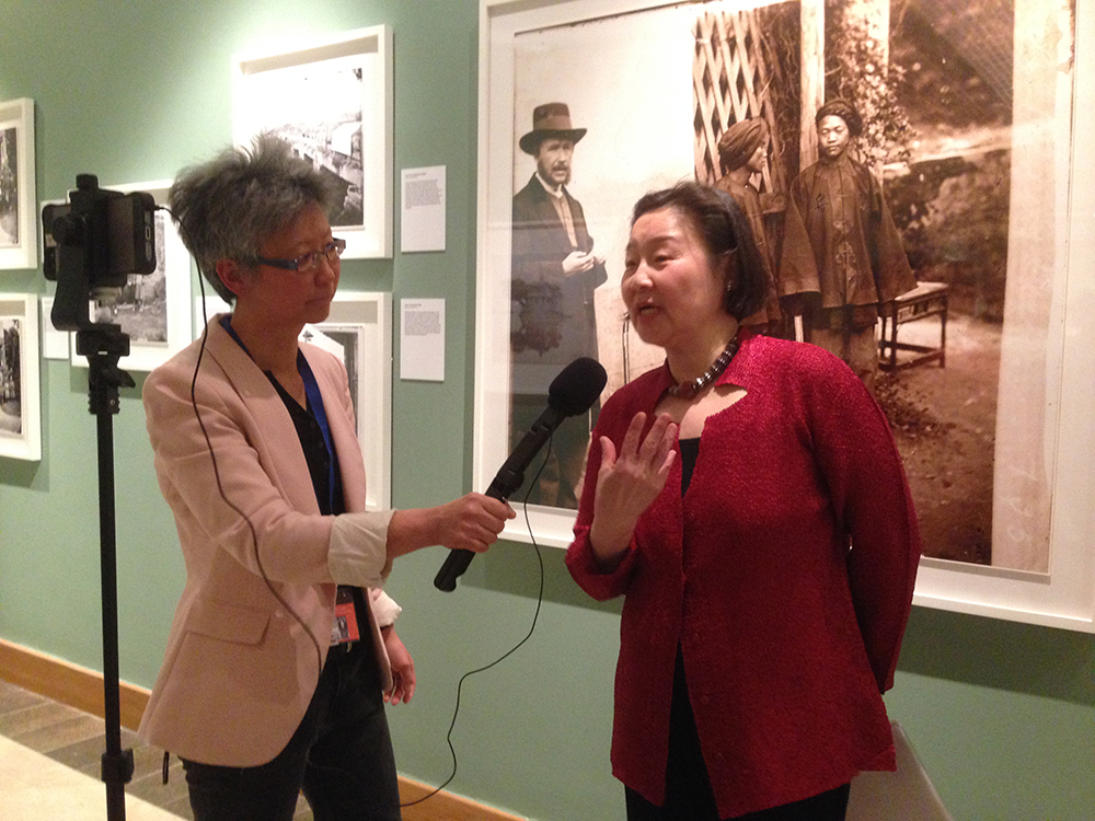 Yang-May Ooi interviewing Betty Yao at the exhibition 'China and Siam Through the Lens of John Thomson', at the Brunei Gallery, SOAS, University of London. Photograph by Jamie Carstairs.