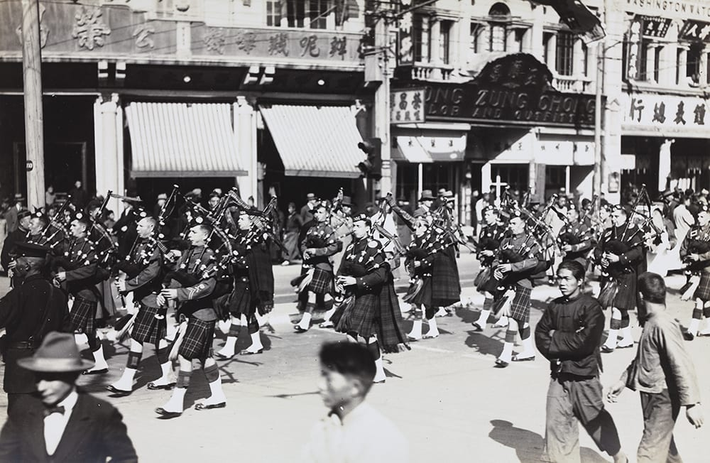 Scots Guards & Shanghai Scottish Pipers, HPC ref AL-s04. The Scots Guards arrived in Shanghai on 2 July 1928 and were based there until 20 January 1929 as part of the British Shanghai Defence Force which was established in January 1927 following an attack on the British concession in Hankow (Hankou) and the surrender of the concession.[2] Note the Chinese on-lookers for whom this was not only a routine ceremonial but, in the highly-charged circumstances of the time, a powerful demonstration of British military capacity.