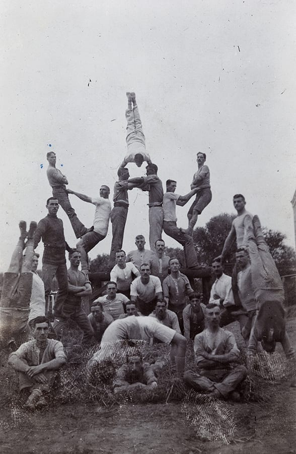 Acrobatic display by Somerset Light Infantry soldiers, c. 1913. HPC ref JC-s056.The sort of photograph that soldiers will have sent in letters home.