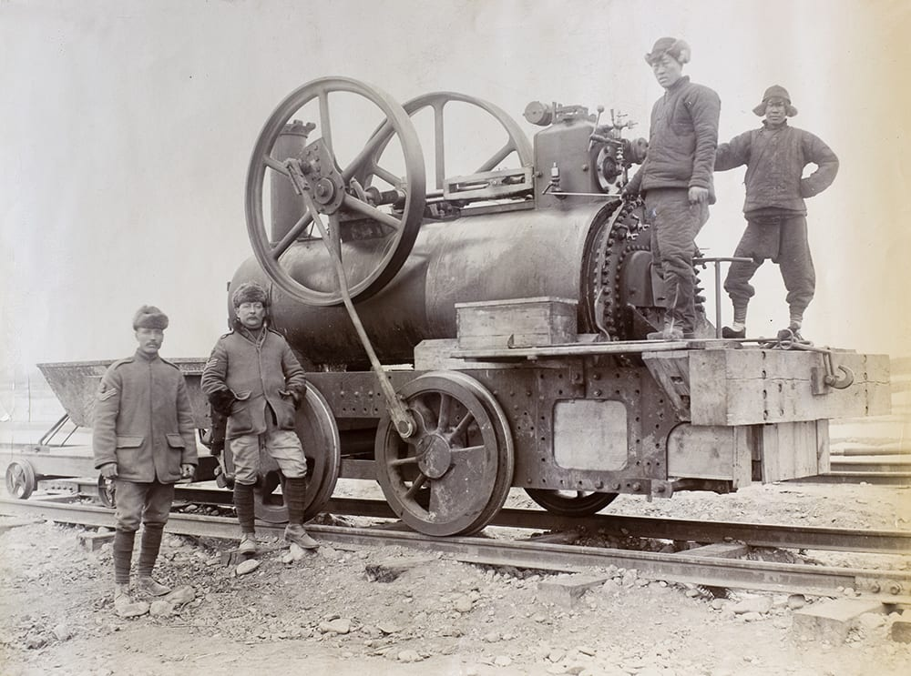 This improvised locomotive was the product of the Royal Engineers No 4. Company of the Bengal Sappers and Miners, under Captain H.R. Stockley. The engine, named 'Grasshopper', had been cobbled together under the supervision of Sergeant A. Tinkham, who was engaged in the reconstruction of Boxer-destroyed railway tracks in and around Fengtai, Peking (Beijing) in 1900. HPC ref NA06-16: a photograph from an album (WO 28/302. China. Boxer Rebellion) in The National Archives. Crown copyright image reproduced by permission of The National Archives, London, England.