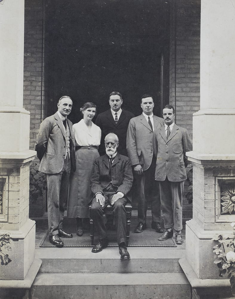 Senior bank staff, including Guy Hillier and R.C. Allen, Hongkong and Shanghai Bank, Beijing, c.1923. Standing, from left to right: R.C. Allen (Accountant), Eleanor Hillier, unidentified man (but not Hubbard), D. A. Johnston, name unconfirmed (possibly J.L.T. Patch). Sitting: Guy Hillier. Guy and Ella were married in Hong Kong on 20 December 1919. Richard Family Collection, Historical Photographs of China ref EH-s63.