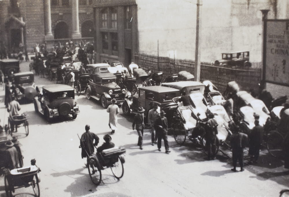 Parked cars and rickshaws, Shanghai, c1930. BL04-83.