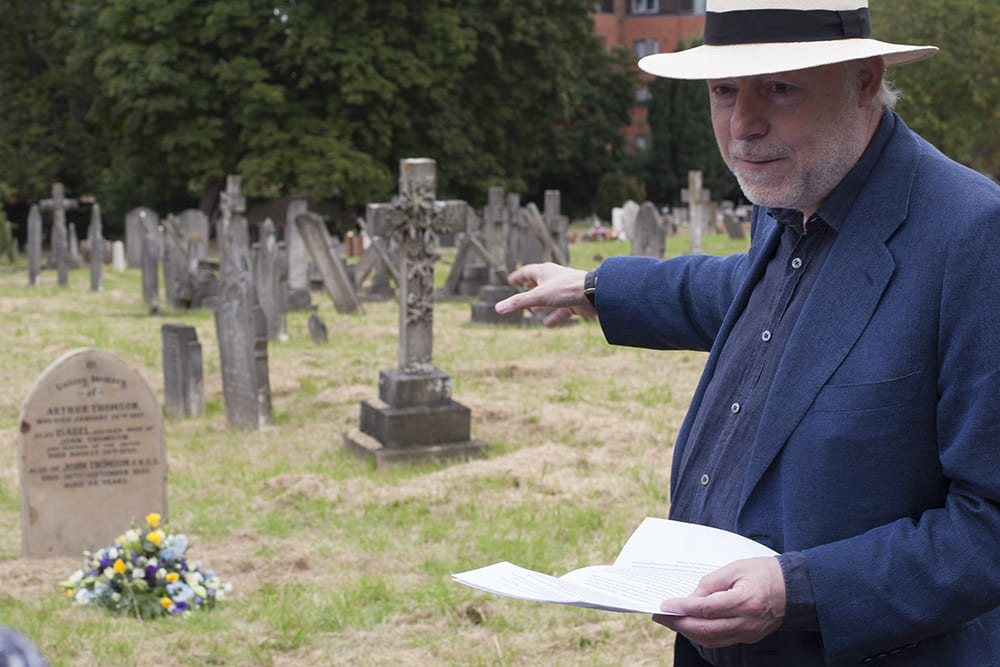 Terry Bennett describing how he found the site of John Thomson's grave in Streatham Cemetery. Photograph by Jamie Carstairs.