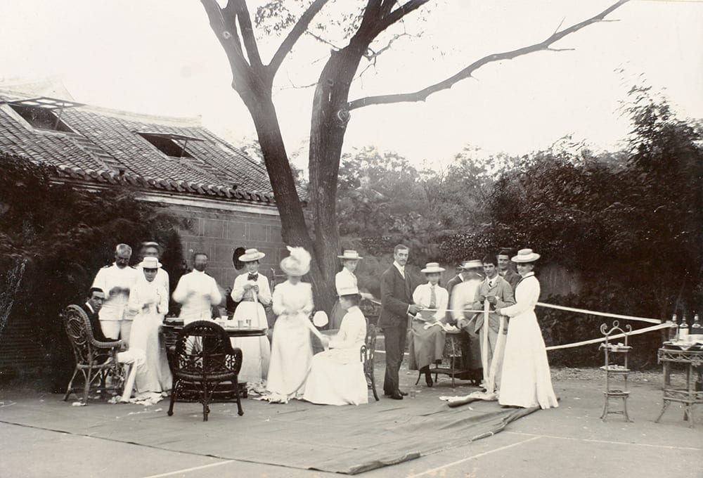 Rolling bandages for the wounded, Weihaiwei, 1900. Since some of the wounded were from the 1st Chinese Regiment, this was, albeit no doubt unintentionally, a moment of common cause between the two communities. Historical Photographs of China ref: Ca01-056.