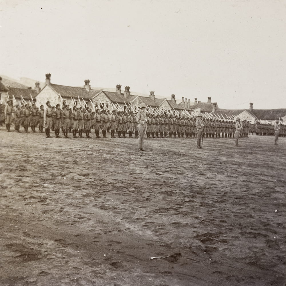 Review of 1st Chinese Regiment on Coronation Day, Weihaiwei, 9 August 1902. This photograph formed part of the Settlement's annual report to the Colonial Office for 1903 (CO 1069/431. CHINA 11. Weihaiwei). Image © The National Archives, London, England. Historical Photographs of China ref: NA08-092.