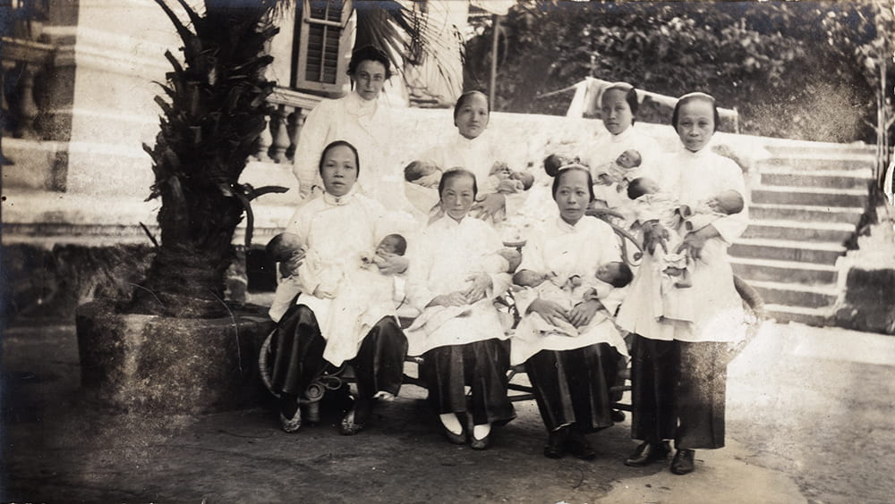 Dr Eleanor Whitworth Mitchell with nurses and newly born babies, outside a maternity hospital, Hong Kong. Historical Photographs of China ref: Mi01-016.