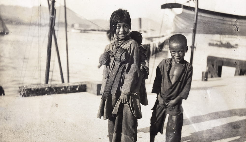 Four children on the waterfront, Hong Kong. Historical Photographs of China ref: Mi01-063.