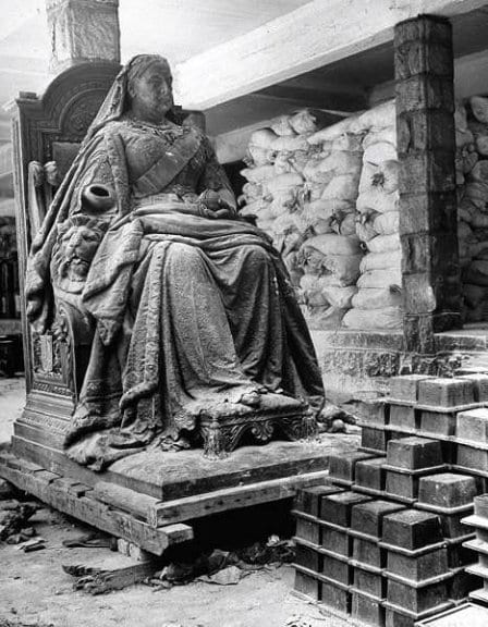 """The statue of Queen Victoria, damaged during the war. Source: Bill Hillman """"Hillman WWII Scrapbook, HMCS Prince Robert Tribute Site""""."""