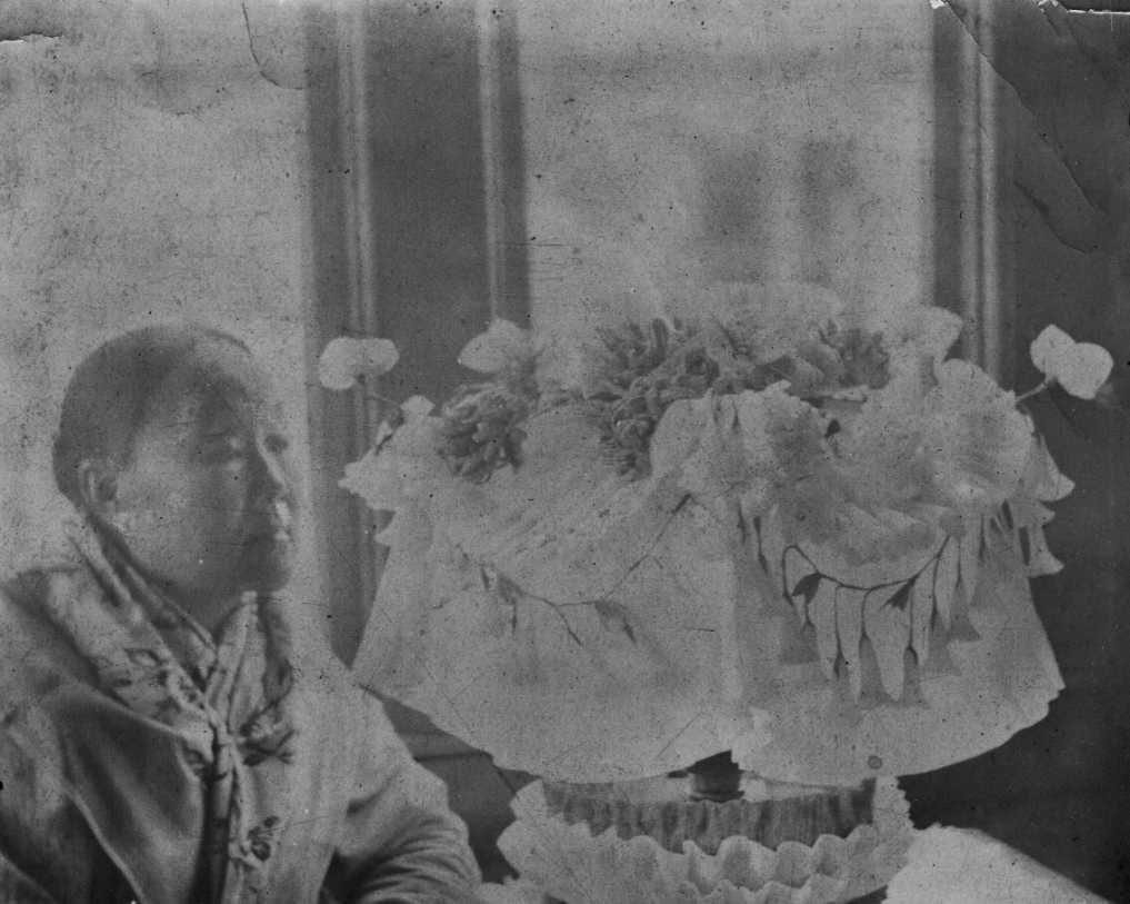 Bibianne Yii (1848/49-1914) married Charles Moore at the British Legation in Beijing on 23 March 1868 and the couple went on to have eleven children. In this photograph, presumably by Charles Moore, Bibianne is said to be sitting next to her wedding headdress (Source: DeeDeeEmme, via Ancestry.com).