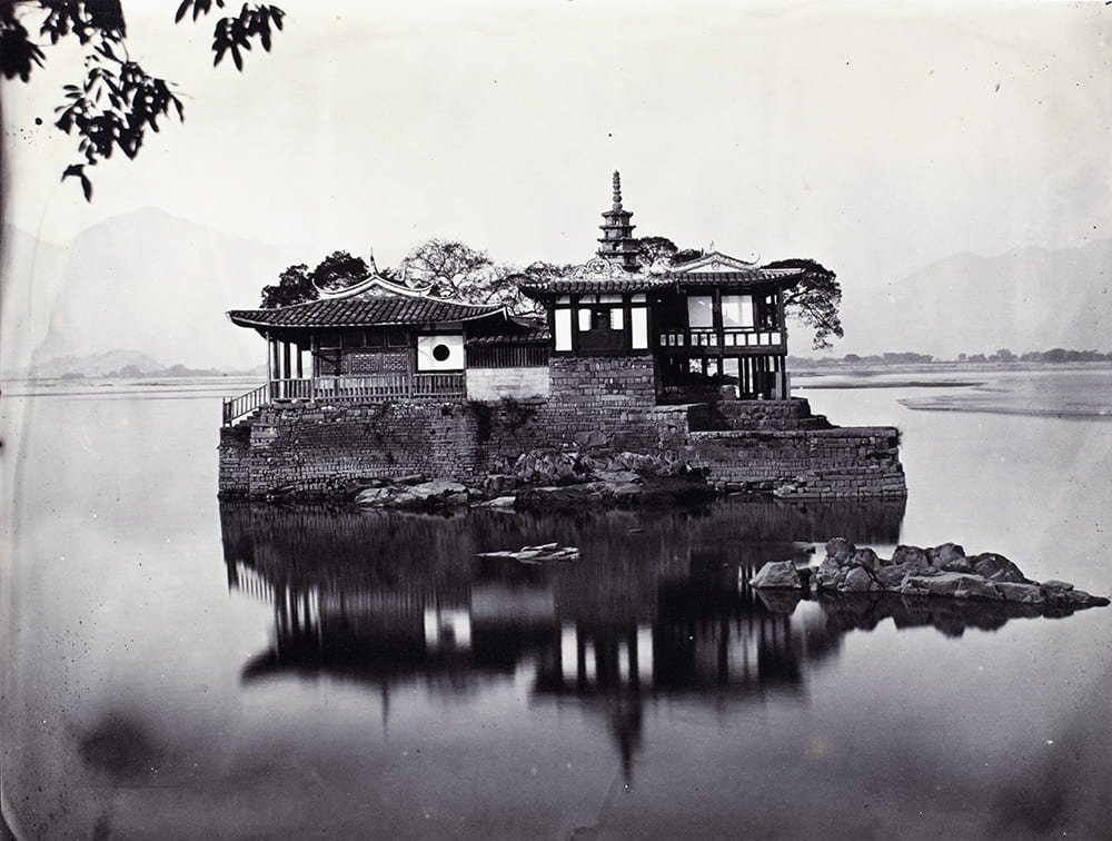 'Little' Jinshan temple (金山塔寺), Wulong River, Fuzhou, c1869. The 'Little Jin Shan' is a pagoda and temple on a small island located in the middle of the Wulong River, which is a branch of the Min River, near the village of Hongtong in the western suburb of the city of Fuzhou in Fujian Province. It resembles the famous Jin Shan (Gold Mountain or Golden Hill) Temple (金山寺) in in Jiangsu Province. Unidentified photographer - perhaps Lai Fong (Afong Studio)? HPC ref: Fr01-002.