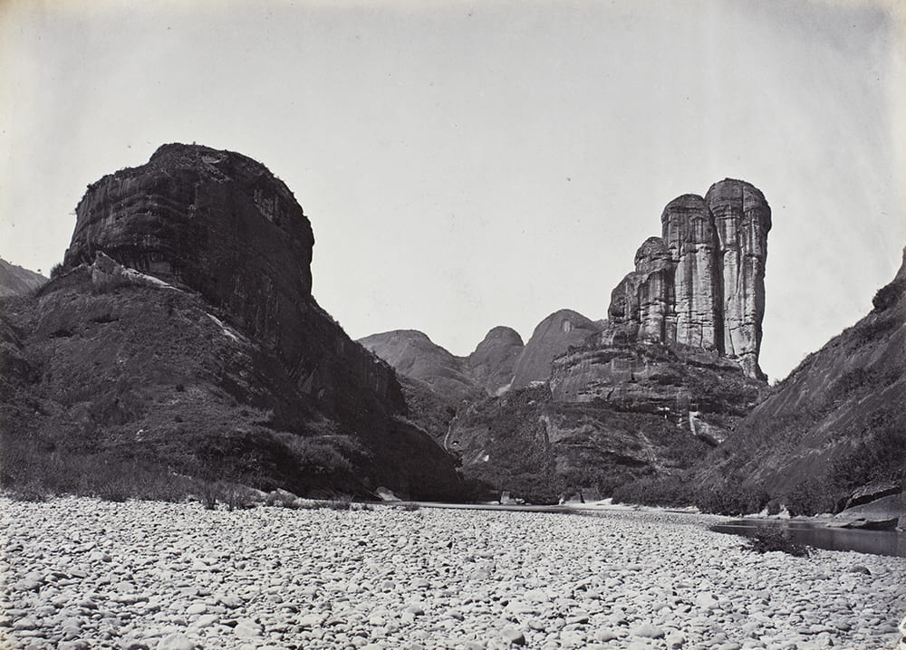 Jade Girl's Mirror-stand Peak on the Nine-bend river, Wuyi Mountains, near Xingcun, Fujian, c1869. Captioned in another album: '94. Gemmy Damsel's Mirror-stand Peak near Sing Chang Tea mart'. Photograph by Lai Fong (Afong Studio). HPC ref: Fr01-079.