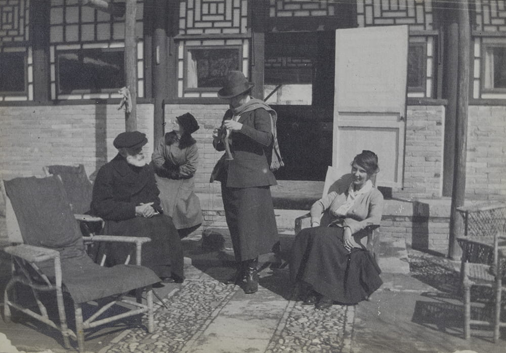 'Sitting out in sun in time of snow' at Balizhuang. From left, Guy, Hatty B., Flo (Florence Harding, Ella's sister) and Ella. HPC ref: EH01-289.