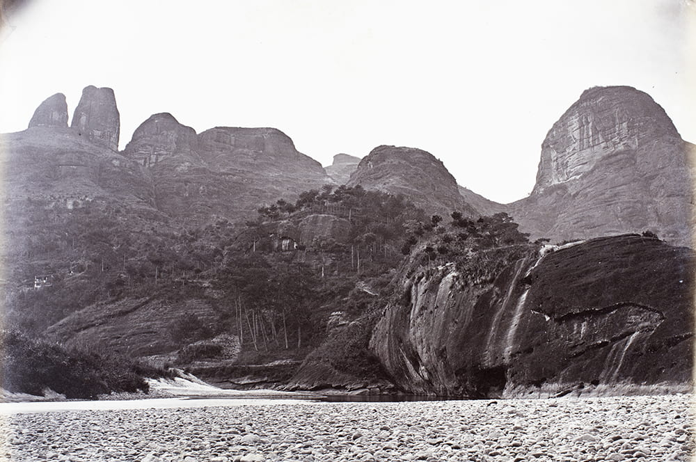 Drum Peak and other Wuyishan peaks, near Xingcun, Fujian, c1869. This is a fine photograph of groves of ancient tea trees in their natural mountain setting, one of several accomplished landscape photographs of dramatic Fujian scenery by Lai Fong. HPC ref: Fr01-090.