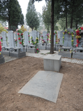 The large granite slab marking Guy's grave at Waiqiao Cemetery, Beijing, inscribed 'sans peur et sans reproche', which survived intact. Author's photograph, 2017.