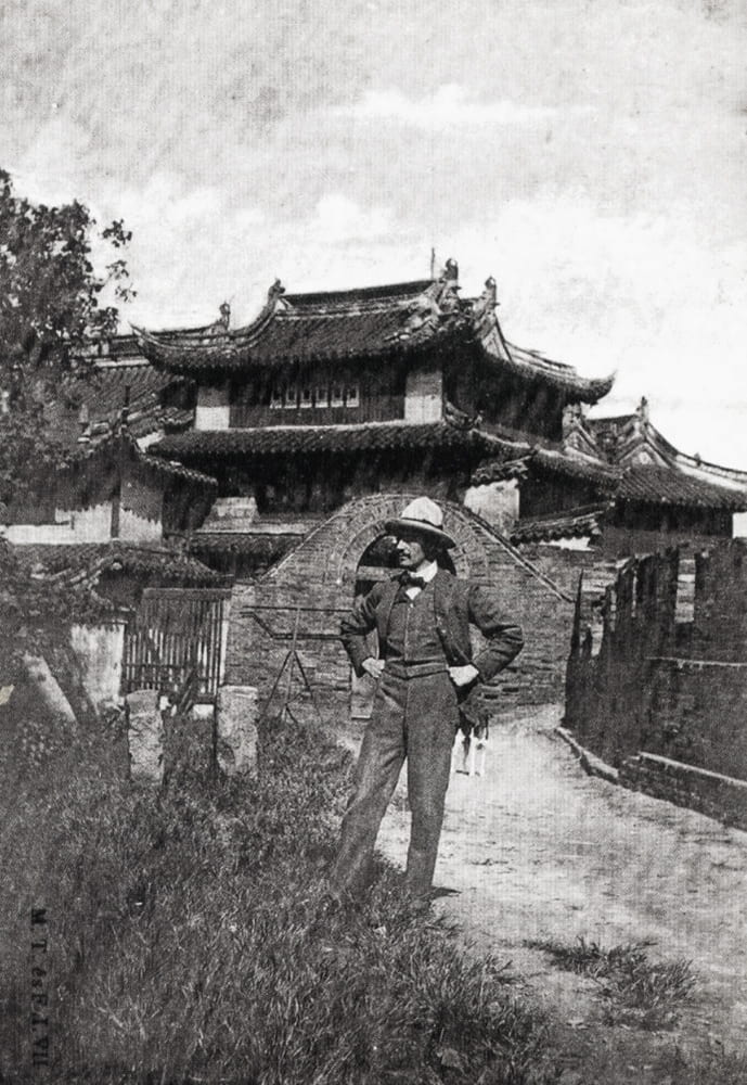 Foreigner on the city wall next to Phoenix Tower, Shanghai. Source unknown.