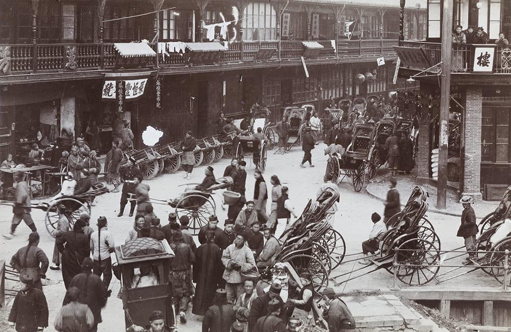 Shops, rickshaws and wheelbarrows outside the New North Gate, Shanghai, c.1890-1900. HPC ref: Wr-s019.