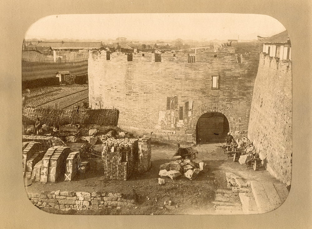 View from the city wall towards the West Gate, Shanghai. Photograph attributed to William Saunders or John Reddie Black. Published by John Reddie Black in 'Far East', January 1877.