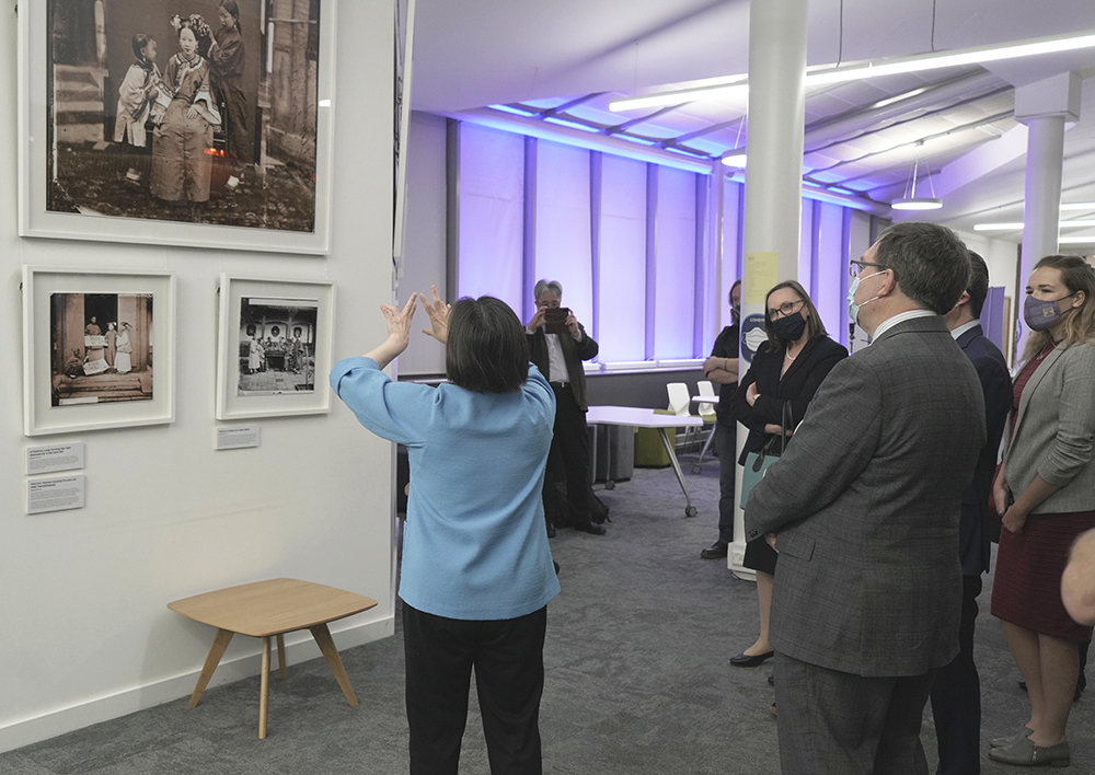 Betty Yao MBE giving a guided tour of the exhibition to Professor Richard Williams, Principal of Heriot-Watt University and Ma Qiang, the Chinese Consul in Edinburgh. Photograph by Michael Pritchard.