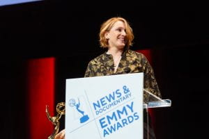 Anna Cavell standing at the emmy podium