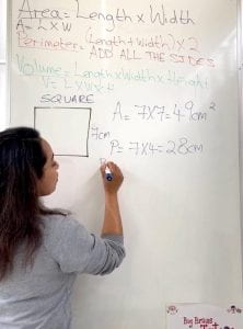 Rupal teaching at her whiteboard