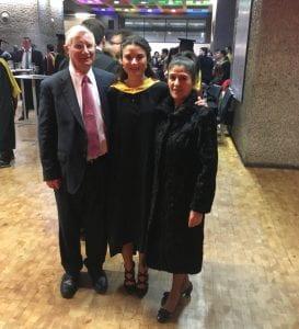 Francisca Posada-Brown at graduation with her parents