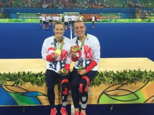 Helen and Kate in Rio sit on the podium and with their gold medals.