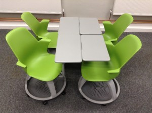 Node chairs configured for groupwork in fours/two pairs around a makeshift table