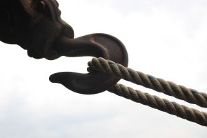 Image of an industrial hook pulling on a rope