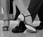 Close up shot of two people dancing tango