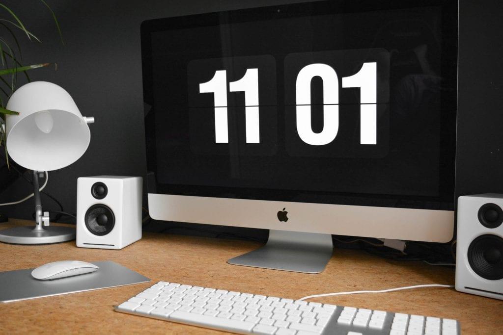 iMac displaying 11:01 on screen
