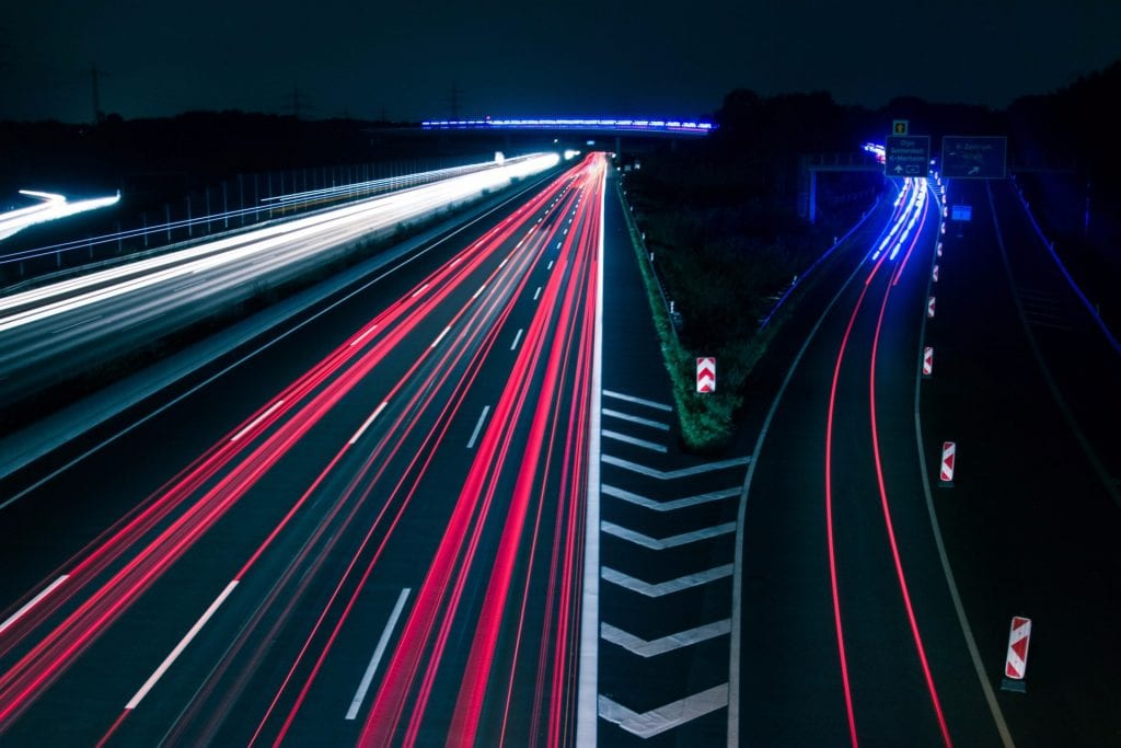 Autobahn at night, with several light trails