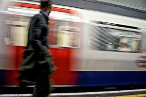 Man on platform as tube train goes past