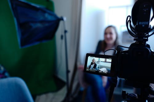 Camera recording speaker in a studio