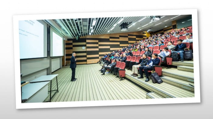Academic, giving a lecture in a full lecture theatre