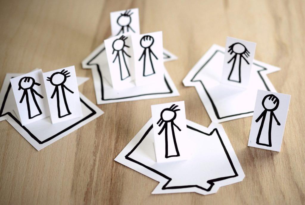 Cartoon figures showing social distancing