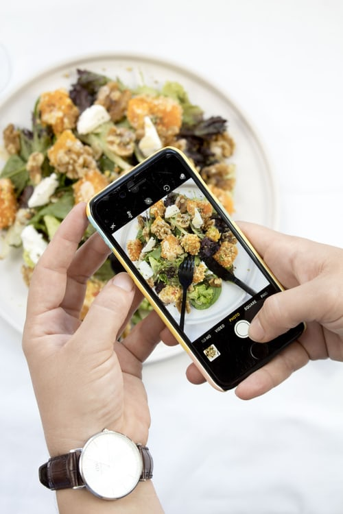 talking a piciture of food with a mobile phone