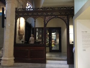 Carved wooden screen leading to the Archive room