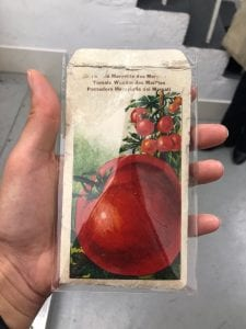 Packet of tomato seeds which contains communist propaganda and tomato seeds inside