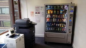 The new vending machine in the corner with its printing neighbours.