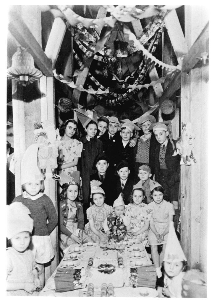 Photo of children at a Christmas party during an air raid