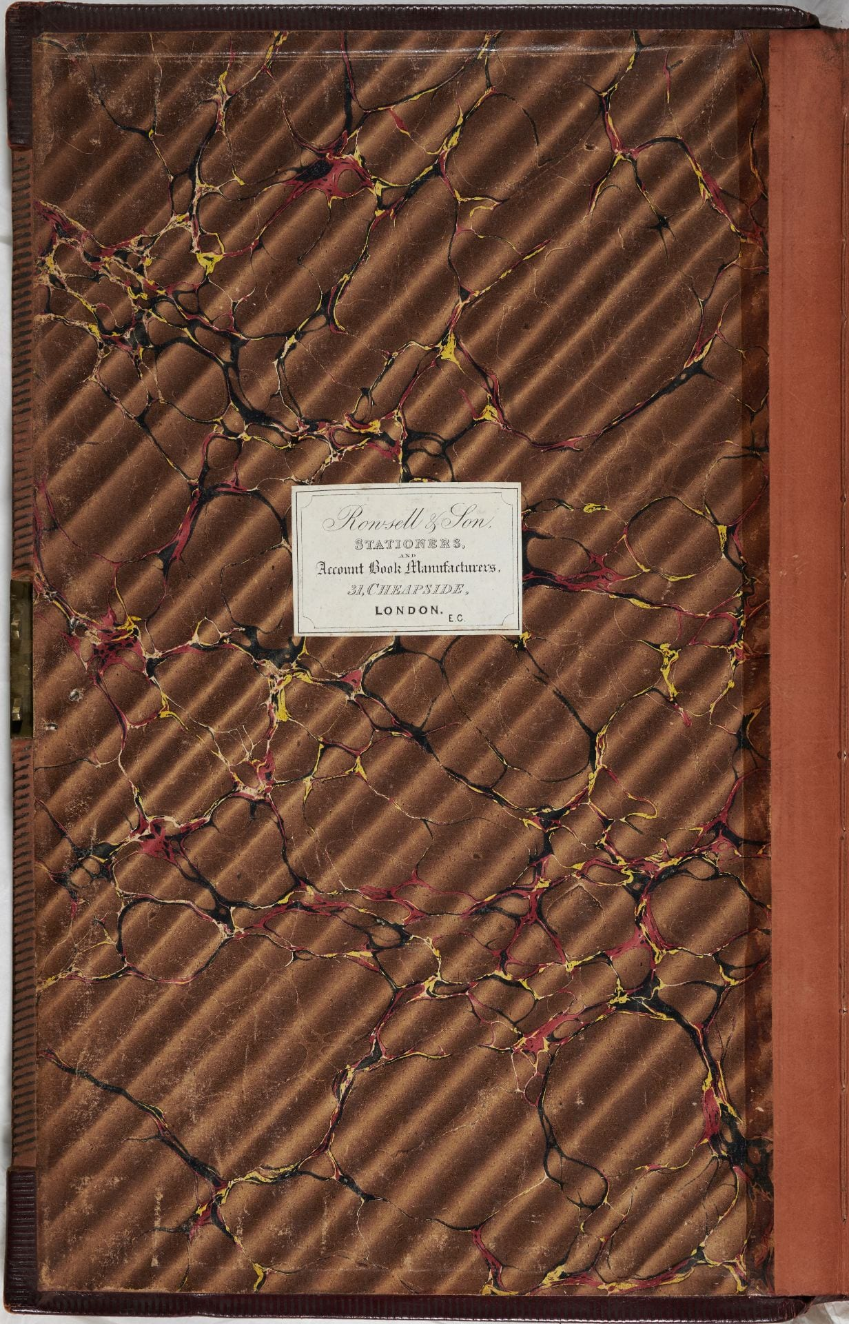 "Financial ledger first endpaper of brown marbled paper.. Label reads ""Ronsell & Son Stationers and Account book manufacturers. 31 Cheapside London EC."