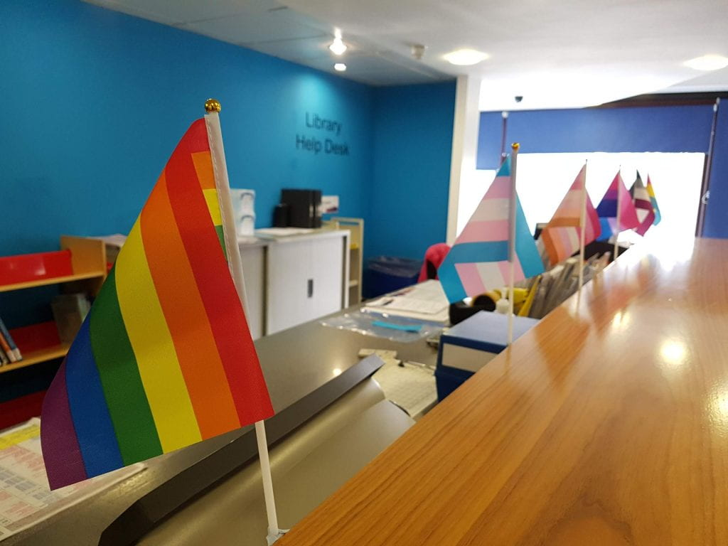 A picture of LGBT flags on Library Help desk