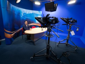 TV studio with bluescreen, autocue and control booth