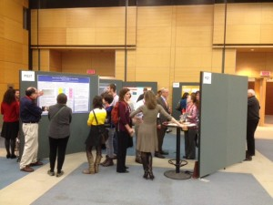 Delegates looking at some of the many poster submissions at ISSOTL 2014.