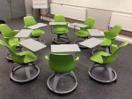 Node chairs laid out for a 'roundtable' discussion activity