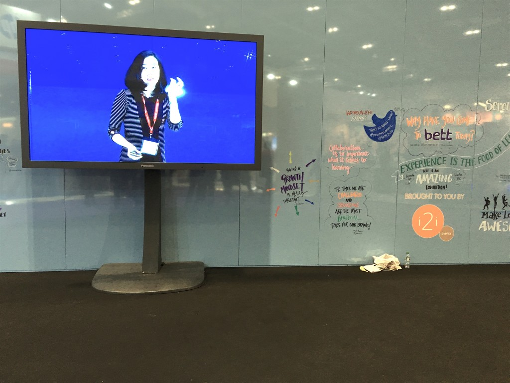 Angela Lee Duckworth on display against a writing wall