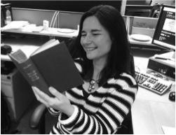 #citylis student Wendy Durham having a giggle at the 'Book of Humour, Wit and Wisdom' that she transcribed for the Victorian Meme Machine competition winner, 2014.