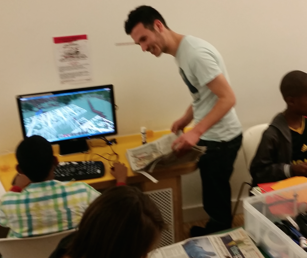 #citylis student Tristan Hooper helping a zine workshop participant make a Minecraft fanzine