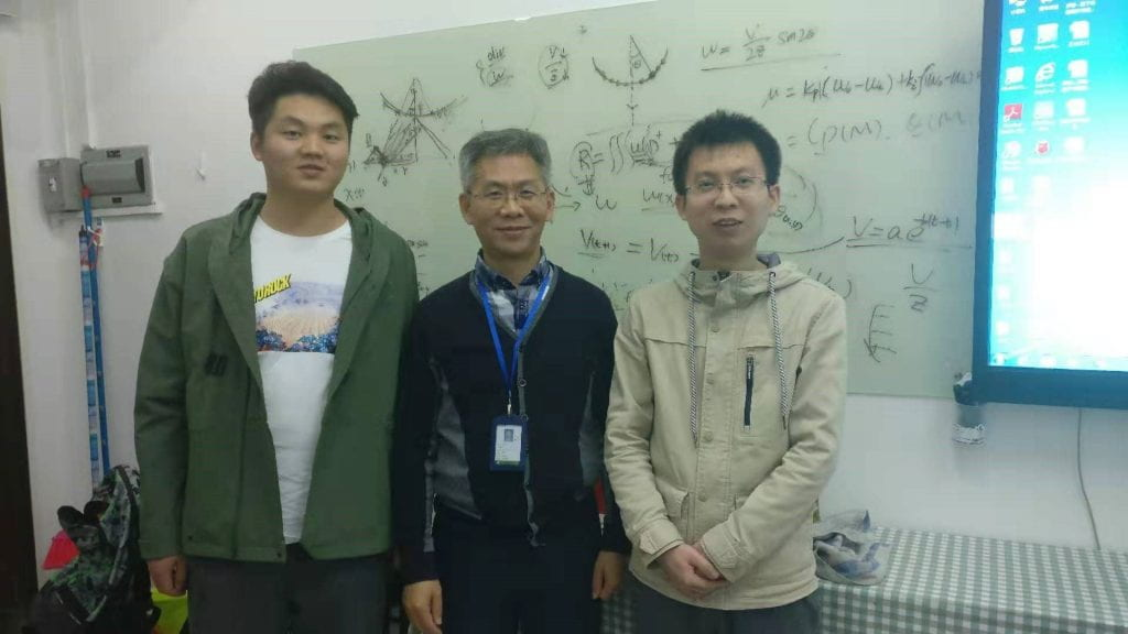 Fig. 2. Discussing with Professor Peng in his office