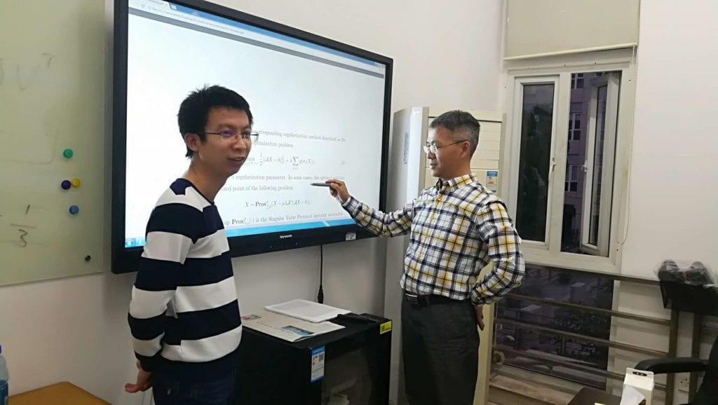 Fig. 3. Discussing with Professor Peng in his office.